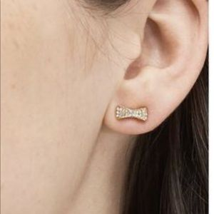 Kate Spade Ready Set Bow gold/ clear earrings.
